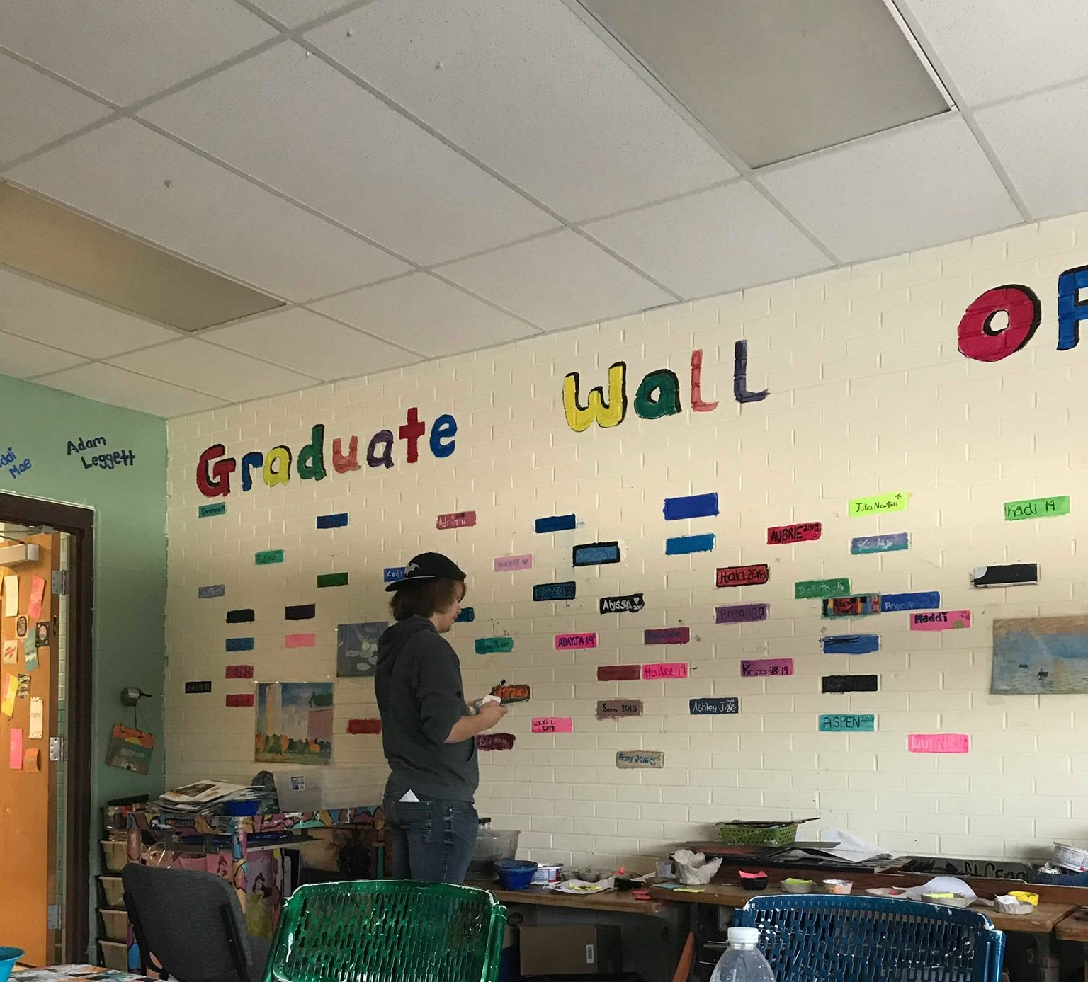 high school graduation wall with student